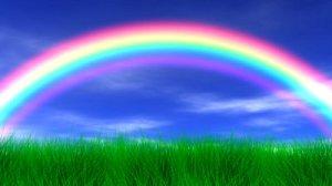 stock-footage-rainbow-grass-and-peaceful-sky